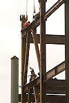 Ironworkers setting structural iron for high rise building