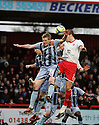 Jeff Hughes of Notts County and Scott Laird of Stevenage contest a header. Stevenage v Notts County - FA Cup 4th Round - Lamex Stadium, Stevenage - 28th January 2012 . © Kevin Coleman 2012