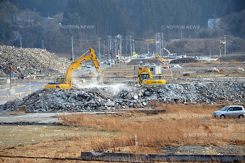 March 8, Minami-Sanriku, Japan - Earth movers level the ground in this seaside community of Shizugawa, Miyagi Prefecture on March 8. The community located deep inside an estuary by the Pacific Ocean was destroyed when the Magnitude 9.0 earthquake and ensuing mounds of tsunami struck the nation's northeast region, leaving more than 15,000 people dead and ravaging wide swaths of coastal towns and villages two years ago on March 11.  (Photo by Natsuki Sakai/AFLO)
