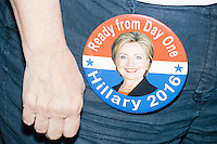 "A woman wears a campaign button featuring Hillary Clinton and reading ""Ready from Day One / Hillary 2016"" at the Democratic National Convention at the Wells Fargo Center in Philadelphia, Pennsylvania, on Wed., July 27, 2016."