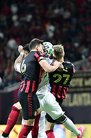 ATLANTA, GA - MARCH 07: ATLANTA, GA - MARCH 07: Atlanta United defenders  Fernando Meza and Laurence Wyke contest for a header during the match against FC Cincinnati, which Atlanta won, 2-1, in front of a crowd of 69,301 at Mercedes-Benz Stadium during a game between FC Cincinnati and Atlanta United FC at Mercedes-Benz Stadium on March 07, 2020 in Atlanta, Georgia.