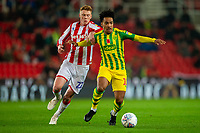 4th November 2019; Bet365 Stadium, Stoke, Staffordshire, England; English Championship Football, Stoke City versus West Bromwich Albion; Matheus Pereira of West Bromwich Albion under pressure from Sam Clucas of Stoke City - Strictly Editorial Use Only. No use with unauthorized audio, video, data, fixture lists, club/league logos or 'live' services. Online in-match use limited to 120 images, no video emulation. No use in betting, games or single club/league/player publications