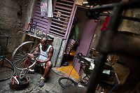 A Cuban service man repairs a bike wheel in the bicycle repair shop in Havana, Cuba, 10 February 2011.