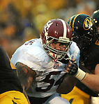 Alabama Crimson Tide defensive lineman Jesse Williams (54) battles the Missouri Tigers in the first half. The Alabama Crimson Tide defeated the Missouri Tigers 42-10 at Memorial Stadium in Columbia, Missouri on October 13, 2012.