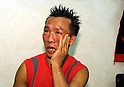 Pornsawan Porpramook (THA), OCTOBER 24, 2011 - Boxing : Pornsawan Porpramook of Thailand looks dejected after the WBA minimumweight title bout at Korakuen Hall in Tokyo, Japan. (Photo by Mikio Nakai/AFLO)