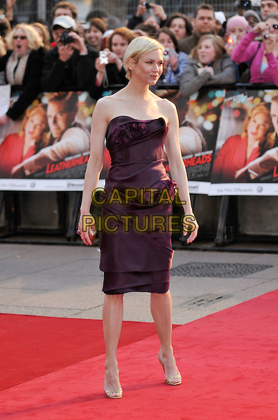 "RENEE ZELLWEGER.Attending the ""Leatherheads"" European Film Premiere  held at the Odeon cinema, Leicester Square London, England, 8th April 2008..full length purple plum aubergine  strapless dress ruffle ruffled front  gold shoes sandals pleated folded ring plum aubergine clutch bag purse .CAP/PL.©Phil Loftus/Capital Pictures..."