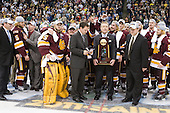 "Bill Watson (Duluth - Volunteer Assistant Coach), Trent Palm (Duluth - 5), Derek Plante (Duluth - Assistant Coach), Kenny Reiter (Duluth - 35), Dale ""Hoagie"" Haagenson (Duluth - Manager), Clay Matvick, Justin Faulk (Duluth - 25), Joe Basaraba (Duluth - 18), Scott Kishel (Duluth - 6), Scott Sandelin (Duluth - Head Coach), ? - The University of Minnesota-Duluth Bulldogs celebrated their 2011 D1 National Championship win on Saturday, April 9, 2011, at the Xcel Energy Center in St. Paul, Minnesota."