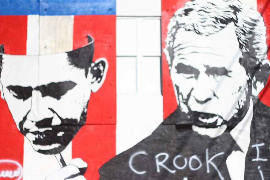Amazing graffiti in wynwood walls , miami one of the hippest neighborhoods in the country showing George W Bush masquerading as OBama