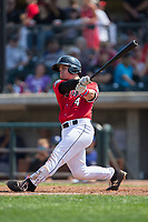 Mark Kolozsvary (4) of the Billings Mustangs follows through on his swing against the Missoula Osprey at Dehler Park on August 20, 2017 in Billings, Montana.  The Osprey defeated the Mustangs 6-4.  (Brian Westerholt/Four Seam Images)