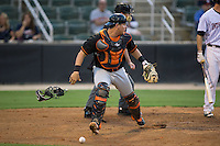 Delmarva Shorebirds catcher Alex Murphy (32) checks the runner at third base as he chases after a wild pitch during the game against the Kannapolis Intimidators at Kannapolis Intimidators Stadium on April 21, 2016 in Kannapolis, North Carolina.  The Intimidators defeated the Shorebirds 9-3.  (Brian Westerholt/Four Seam Images)