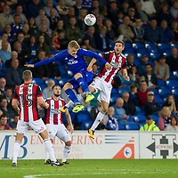 Danny Ward of Cardiff City challenges Chris Basham of Sheffield United during the Sky Bet Championship match between Cardiff City and Sheffield United at Cardiff City Stadium, Cardiff, Wales on 15 August 2017. Photo by Mark  Hawkins / PRiME Media Images.