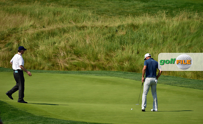 Dustin JOHNSON (USA) did the ball move or not as he grounded his putter at 5th green during fourth round 116th US Open 2016 ,Oakmont Country Club, Pittsburgh,Pennsylvania,USA.