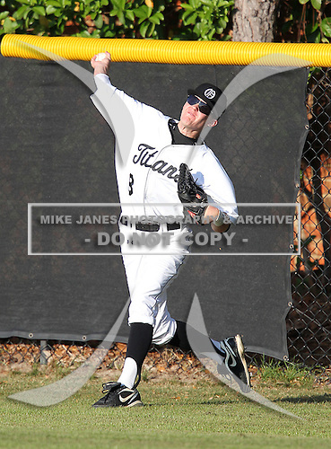 Austin Bottoms of the Olympia Titans varsity baseball team during a game against the Montverde Academy Eagles at Olympia High School on March 7, 2011 in Orlando, Florida.  (Copyright Mike Janes Photography)
