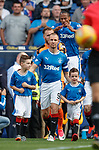 Rangers captain Kenny Miller leads out the teams