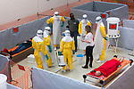 Training center in Amsterdam, Netherlands for MSF (Doctors Without Borders) staff being trained in EBOLA protocols for work in Africa such as safe dressing and undressing of protective suits and handling gear.