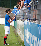 Bilel Mohsni spends 10 minutes after the game signing autographs for Rangers fans