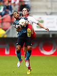 Nederland, Utrecht, 16 september 2012.Eredivisie.Seizoen 2012-2013.FC Utrecht-PSV.Jeremain Lens (l.) van PSV en Dave Bulthuis (r.) van FC Utrecht strijden om de bal. Lens maakt hands.