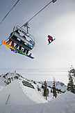 USA, California, Mammoth, a snowboarder catches air off a jump at Mammoth Ski Resort