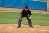 Base umpire Brad Hungerford handles the calls on the bases during the game between the UC-Riverside Highlanders and the Cal Poly San Luis Obispo Mustangs at Riverside Sports Complex on May 26, 2018 in Riverside, California. The Cal Poly SLO Mustangs defeated the UC Riverside Highlanders 6-5. (Donn Parris/Four Seam Images)