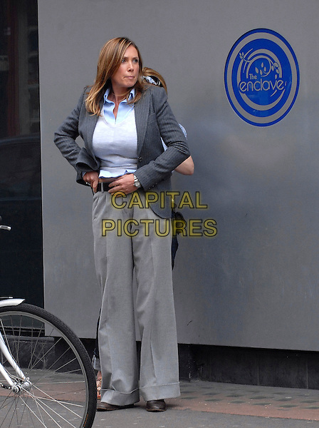 "SALLY ROGERS.Filming scenes for ITV's ""The Bill"" in Soho, London, England, UK, .August 11th 2009..full length grey gray suit jacket trousers the enclove shirt detective filmset film set on location .CAP/IA.©Ian Allis/Capital Pictures"
