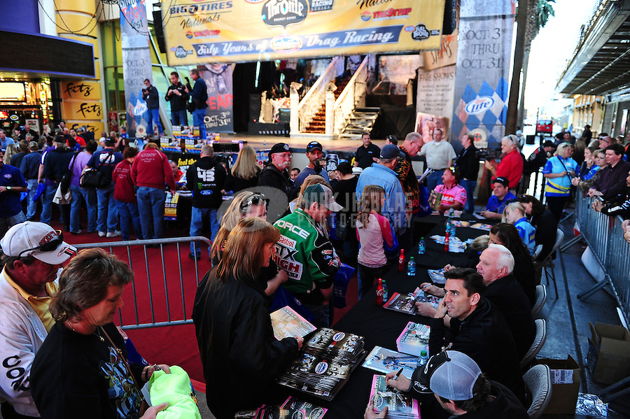 Oct. 27, 2011; Las Vegas, NV, USA: NHRA drivers during sign autographs during the fanfest at Fremont Street. Mandatory Credit: Mark J. Rebilas-US PRESSWIRE