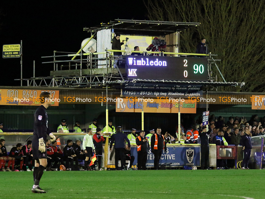 Scoreboard refers to MK Dons as MK during AFC Wimbledon vs MK Dons, Sky Bet EFL League 1 Football at the Cherry Red Records Stadium on 14th March 2017