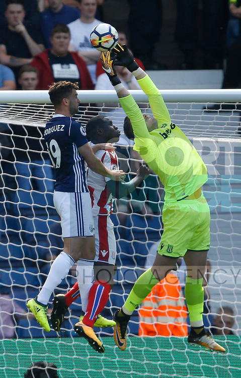 Jack Butland of Stoke City denies Jay Rodriguez of West Bromwich Albion during the premier league match at the Hawthorn's Stadium, West Bromwich. Picture date 27th August 2017. Picture credit should read: Simon Bellis/Sportimage