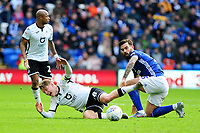 George Byers of Swansea City is fouled by Marlon Pack of Cardiff City during the Sky Bet Championship match between Cardiff City and Swansea City at the Cardiff City Stadium in Cardiff, Wales, UK. Sunday 12 January 2020