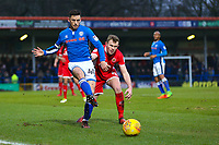 Rochdale's Ian Henderson (left) and Walsall's Nicky Devlin (R) during the Sky Bet League 1 match between Rochdale and Walsall at Spotland Stadium, Rochdale, England on 23 December 2017. Photo by Juel Miah / PRiME Media Images.