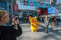 A small person in a Pokemon costume amuses attendees at the 113th North American International Toy Fair in the Jacob Javits Convention center in New York on Sunday, February 14, 2016.  The four day trade show with over 1000 exhibitors connects buyers and sellers and draws tens of thousands of attendees.  The toy industry generates over $84 billion worldwide and Toy Fair is the largest toy trade show in the Western Hemisphere. (© Richard B. Levine)
