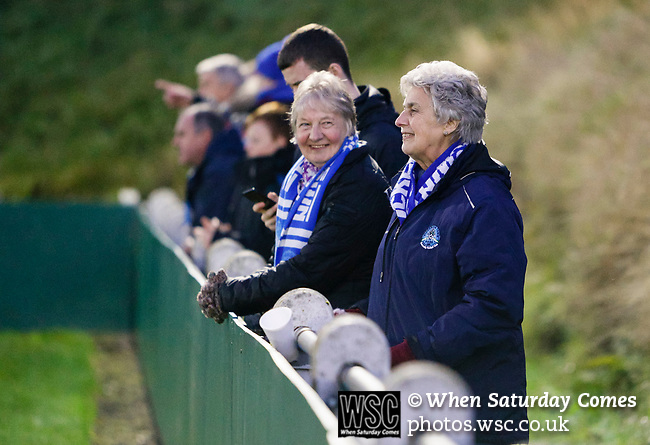 Pickering fans share a joke. Stocksbridge Park Steels v Pickering Town, Evo-Stik East Division, 17th November 2018. Stocksbridge Park Steels were born from the works team of the local British Steel plant that dominates the town north of Sheffield.<br /> Having missed out on promotion via the play offs in the previous season, Stocksbridge were hovering above the relegation zone in Northern Premier League Division One East, as they lost 0-2 to Pickering Town. Stocksbridge finished the season in 13th place.