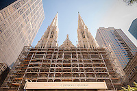 St. Patrick's Cathedral on Fifth Avenue in New York is covered in scaffolding on Friday, October 3, 2014. The over 130 year-old house of worship is in the second-phase of a full restoration which will cost approximately $175 million. The cathedral sees over five and one-half million visitors year and is a major tourist destination. (© Richard B. Levine)