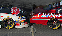 Apr 26, 2008; Talladega, AL, USA; NASCAR Nationwide Series driver Dale Earnhardt Jr (left) bump drafts Tony Stewart during the Aarons 312 at the Talladega Superspeedway. Mandatory Credit: Mark J. Rebilas-