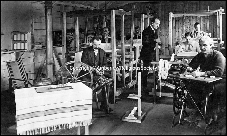 BNPS.co.uk (01202 558833)Pic: Amberley/ReligiousSociety/BNPS<br /> <br /> Weaving was one of the crafts that the Quakers established at Knockaloe Camp on the Isle of Man to help occupy the internees and enable them to earn a small income.<br /> <br /> These remarkable photos feature in a new book which highlights the crucial role volunteers played in the First World War.<br /> <br /> Former archaeologist Sally White has shed new light on the tireless efforts of men, women and children who supported the soldiers both on the front line and at home.<br /> <br /> They include heiress Lady Dorothie Feilding who shunned her aristocratic background to become a highly decorated volunteer nurse and ambulance driver on the Western Front.