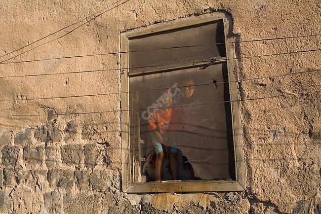 In the city of Al Rastan, Syria.