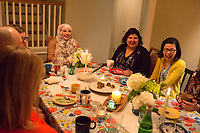 "SEATTLE, WA-APRIL 17, 2017: Amanda Saab, center, Anjana Agarwal,  and Charissa Pomrehn (yellow sweater, right) had a lot to laugh about during the dinner party.<br /> <br /> Amanda Saab, along with her husband Hussein Saab, co-hosted a ""dinner with your Muslim neighbor"" at the home of Stefanie and Nason (cq) Fox in Seattle, WA on a return trip April 17th 2017. The couple now live in Detroit. (Photo by Meryl Schenker/For The Washington Post)"