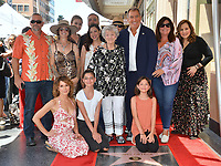 LOS ANGELES, CA. July 24, 2019: Kenny Ortega & family at the Hollywood Walk of Fame Star Ceremony honoring Kenny Ortega.<br /> Pictures: Paul Smith/Featureflash