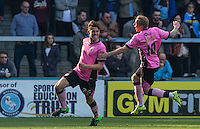 Nicky Adams of Northampton Town runs to celebrate with goal scorer Shaun Brisley (left) of Northampton Town during the Sky Bet League 2 match between Wycombe Wanderers and Northampton Town at Adams Park, High Wycombe, England on 3 October 2015. Photo by Andy Rowland.