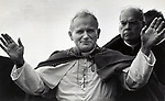 After a morning of pouring rain, Pope John Paul II arrived and spoke at the Battery Park in Manhatten on October 3, 1979.  Photo by Jim Peppler/copyright Newsday1979. All Rights Reserved.