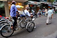 Tourists riding in Cyclos, Ho Chi Minh City (Saigon), Vietnam