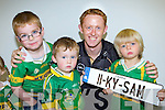 Connie Counihan, Jack Ahern and Mark Farrell meets their hero Kerry Captain Colm Cooper in Ahern's Garage Castleisland on Tuesday