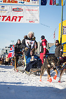 Ralph Johannessen and team leave the ceremonial start line at 4th Avenue and D street in downtown Anchorage during the 2014 Iditarod race.<br /> Photo by Jim R. Kohl/IditarodPhotos.com
