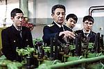 Baku - Azerbaijan - 08 December 2014 -- Azerbaijan State Marine Academy. -- Instructor and teacher Ismailov Mekhman (ce) during a lesson on the power plants of ships with students (f. left) Kenjaliyev Kayrat (19), Askarov Nazbek (18) and Bakitov Ruslan (18) . -- PHOTO: Sitara Ibrahimova / EUP-IMAGES