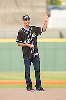 Joey Logano, driver of the #22 Ford Fusion for Team Penske, waves to the crowd before throwing out a ceremonial first pitch prior to the International League game between the Norfolk Tides and the Charlotte Knights at BB&T Ballpark on May 21, 2014 in Charlotte, North Carolina.  (Brian Westerholt/Four Seam Images)