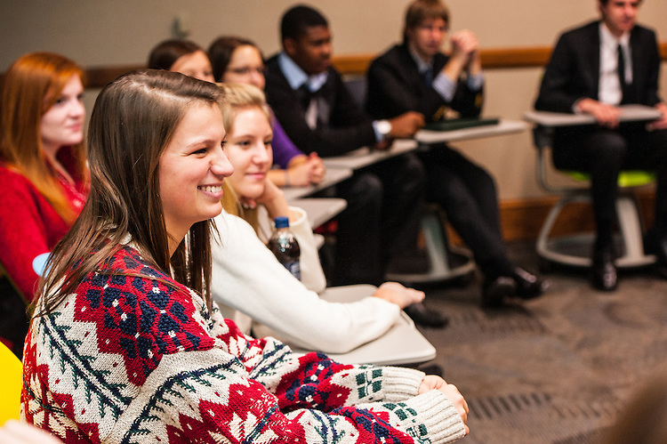 Taylor Tatman, freshman, gives her one word description of her semester's experience during The College of Business Honors Program's Christmas party in Copeland Hall on Wednesday, December 5, 2012.