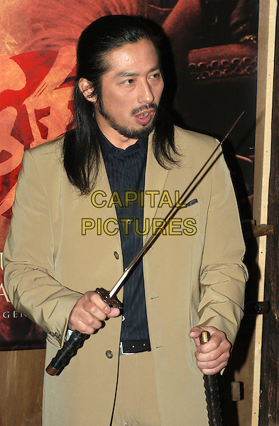 HIROYUKI SANADA.The Last Samurai Italian premiere, Rome.*Not for sale in Italy*.7 January 2004.sword, half length, half-length, funny.www.capitalpictures.com.sales@capitalpictures.com.©Capital Pictures