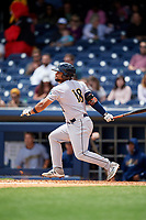 New Orleans Baby Cakes designated hitter Tomas Telis (18) follows through on a swing during a game against the Nashville Sounds on May 1, 2017 at First Tennessee Park in Nashville, Tennessee.  Nashville defeated New Orleans 6-4.  (Mike Janes/Four Seam Images)