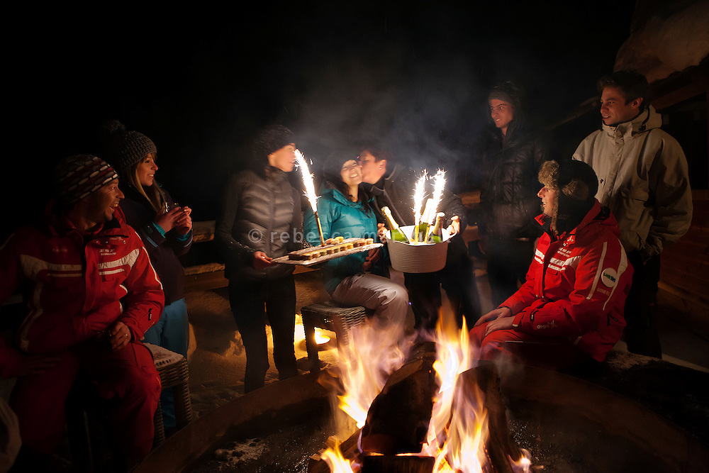A guest's birthday is celebrated with a cake and sparklers on the terrace of Chalet Refuge Vé la Marie, La Clusaz, France, 15 February 2012.