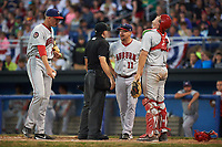Auburn Doubledays manager Jerad Head (11) argues a play at the plate with umpire Drew Saluga as catcher Nic Perkins (43) looks up and relief pitcher Gabe Klobosits (31) points to the spot the runner slid in during a game against the Batavia Muckdogs on July 4, 2017 at Dwyer Stadium in Batavia, New York.  Batavia defeated Auburn 3-2.  (Mike Janes/Four Seam Images)