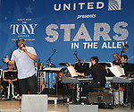 James Monroe Iglehart performing at United presents 'Stars in the Alley' in  Shubert Alley on May 27, 2015 in New York City.